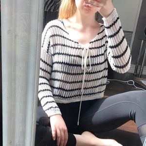 White and black knit long sleeve shirt